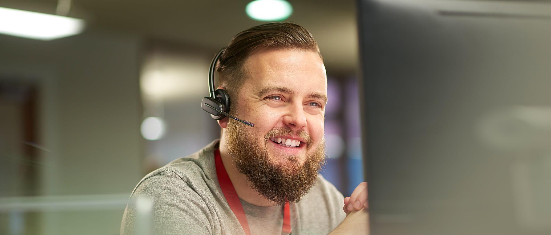 man on phone using headset
