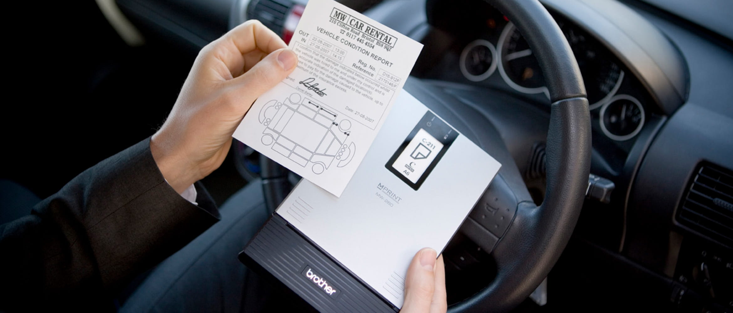 Individual in car using Brother MW range  mobile printer