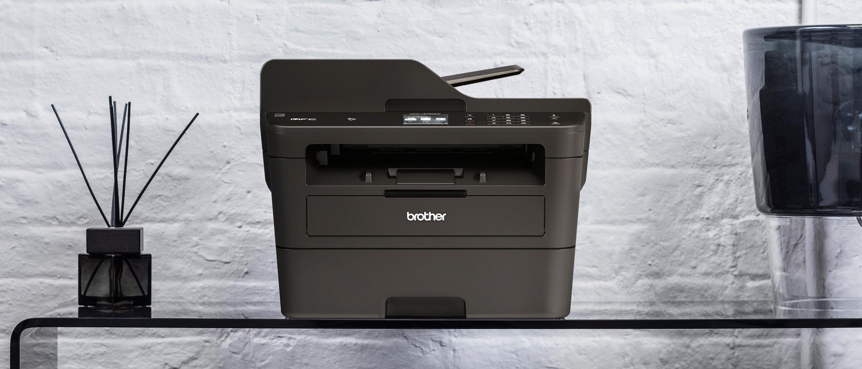 Black Brother Monolaser Printer on glass table