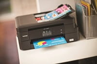 Brother printer on shelf printing colour documents