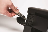 Person inserting USB flash drive into Brother printer