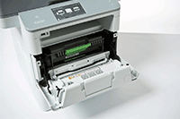 Close up of 3 in 1 printers with paper tray pulled out