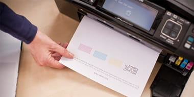 Closeup of a person collecting a printed document