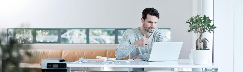 Man sat on laptop at desk